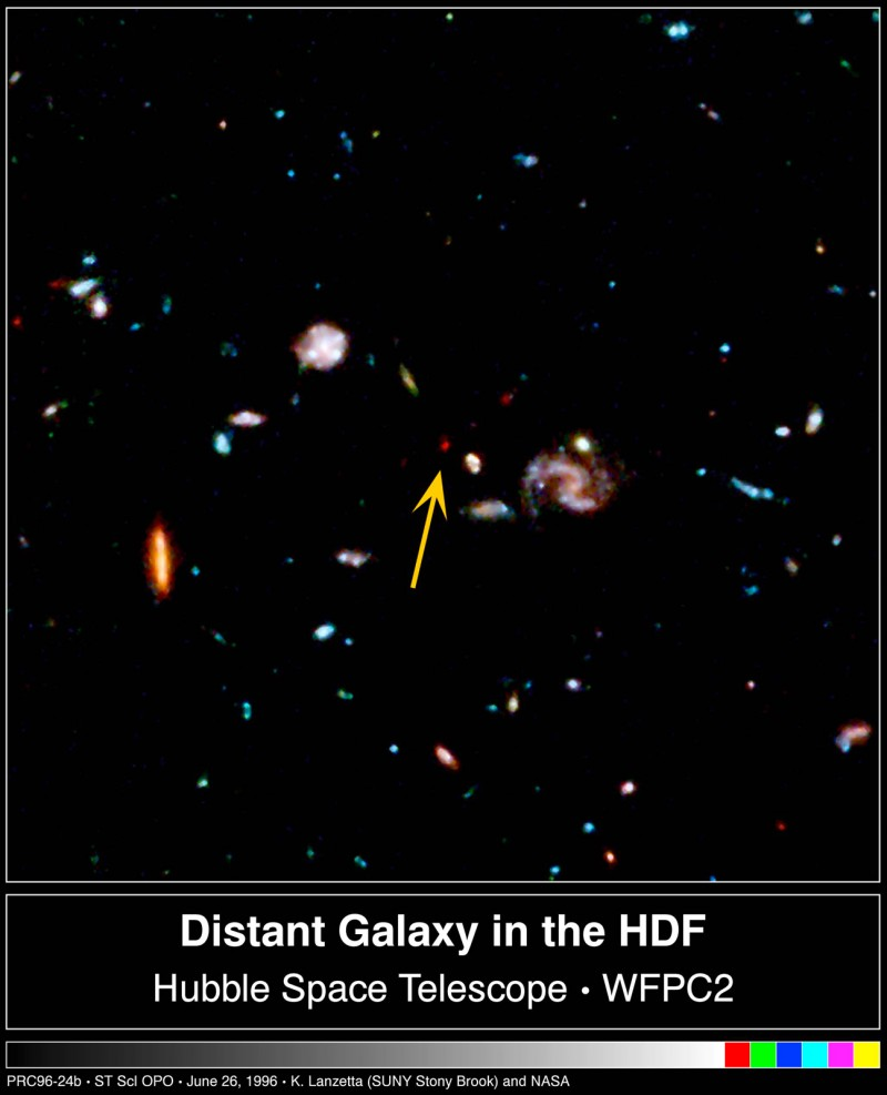 An image of the universe recorded by Nasa's Hubble Telescope in December of 1995 and analyzed by Amos Yahil and his colleagues.  The arrows point to a super-faint galaxy that appears to be more distant than any other previously known galaxy. © K. Lanzetta and A. Yahil (SUNY) and NASA.